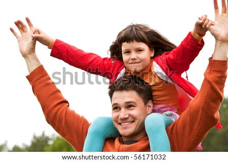 The father with the daughter on the nature - stock photo