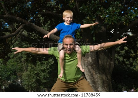 The father with the son play park - stock photo
