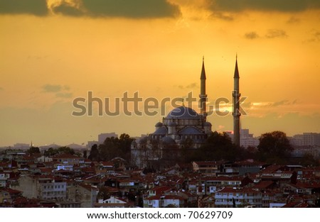 The Fatih Mosque punctuates Istanbul's Skyline at Sunset - stock photo