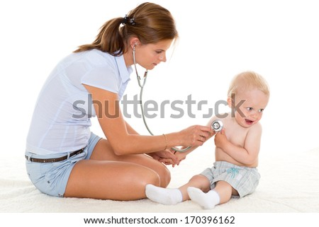 The female doctor with a stethoscope and the small patient on a white background.