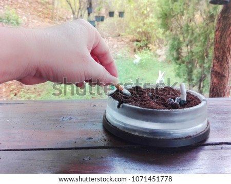 Female Hand Rubbing Bottom Cigarette Butts Stock Photo Image