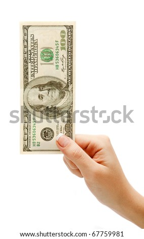 the Female hand with money isolated on a white background - stock photo