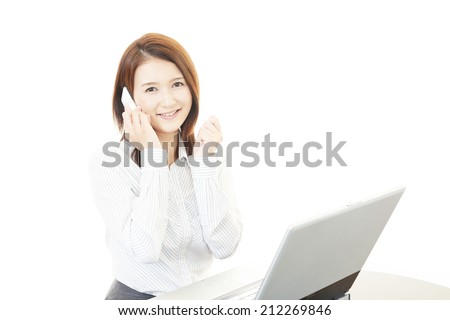 The female office worker who poses happily