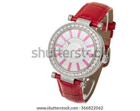 The female watch covered with jewels and decorated with diamonds with a red leather thong, on a white background nobody. - stock photo