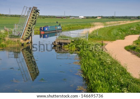 The fens in East Anglia are a marshy region, artificially drained and transformed into arable farming area with grains, vegetables and some cash crops such as rapeseed or canola. - stock photo