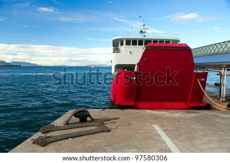 The ferry at the pier - stock photo