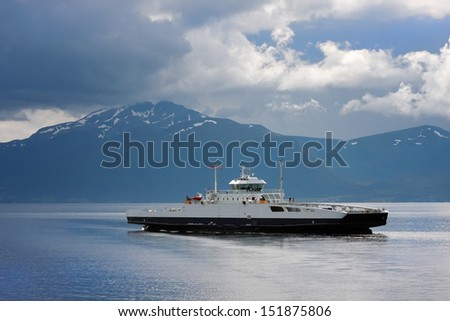 The ferry transporting transport and passengers, in waters of the Norwegian fjord