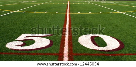 The fifty yard line of a football field - stock photo