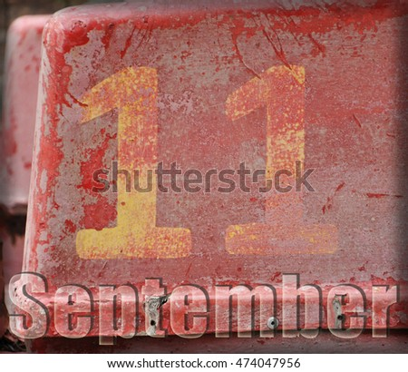 "the figure eleven on a red shabby background. the inscription ""September"""