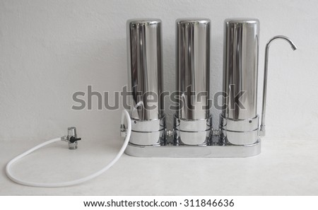 The filter for tap water clearing and treating on a plain background. - stock photo