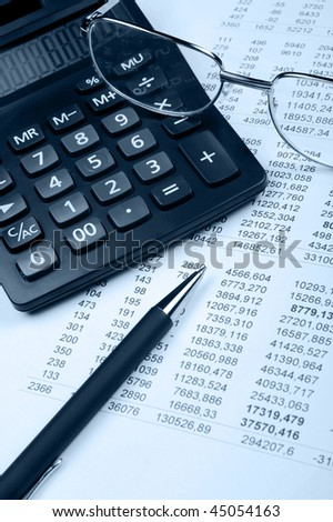 The financial report. A workplace of the financier. Blue tone - stock photo