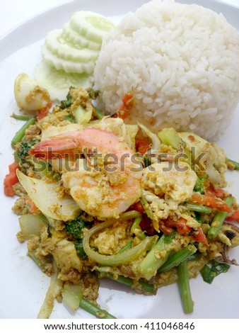 The fired curry shrimp and squid, mix seafood with mix vegetable. Phat phong kari in Thai, Thai Food. - stock photo