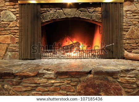 The fireplace, where everyone want to sit behind. - stock photo