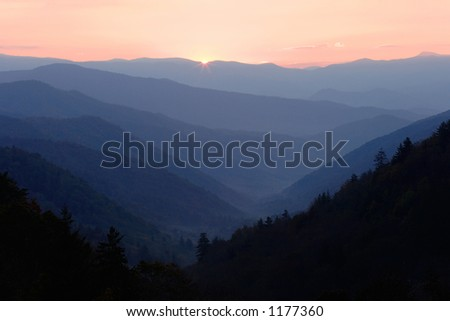 The first glimpse of sunlight over the peaks of the Smoky Mountains Nat. park, USA.