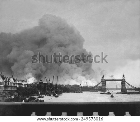 The first mass German air raid on London, during World War 2. Tower Bridge stands out against a background of smoke and fires. Sept. 7, 1940. - stock photo