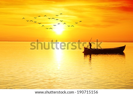 the fisherman in the sea at sunrise - stock photo