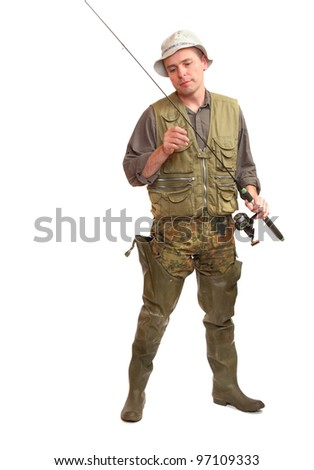 The fisherman with fishing rod. - stock photo