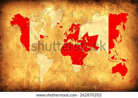 The flag of Canada in the outline of the world map - stock photo