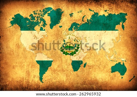 The flag of El Salvador in the outline of the world map - stock photo