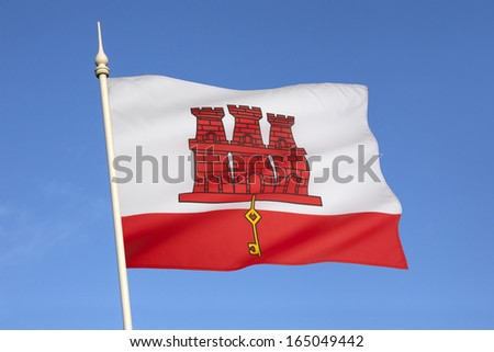 The flag of Gibraltar is an elongated banner of the coat of arms of Gibraltar, granted by Royal Warrant Queen Isabella I of Castile on 10 July 1502. - stock photo