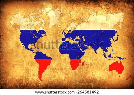 The flag of Russia in the outline of the world map - stock photo
