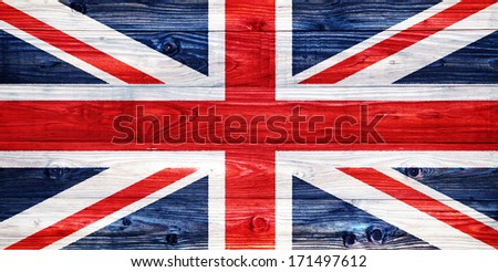The Flag of the United Kingdom on a weathered wooden wall - stock photo