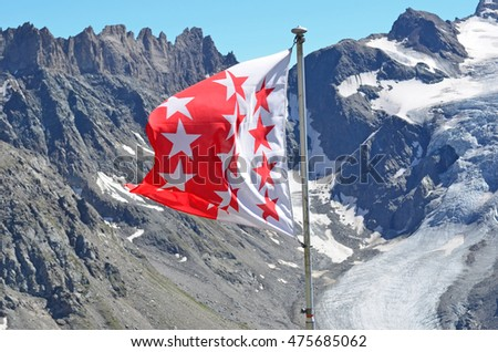 The flag of the Valais (Wallis in german) in southern switzerland. A mountains canton in the alps