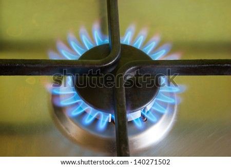 The flame of gas burner on the stove - stock photo