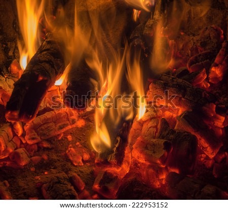 the flames dancing on the last coals - stock photo