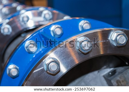 The flanges of valves with bolts and nuts - stock photo