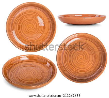 The flat earthenware dish with a spiral pattern. Set photos from different angles on a white background - stock photo
