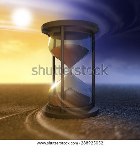 The flow of time and hourglass - stock photo