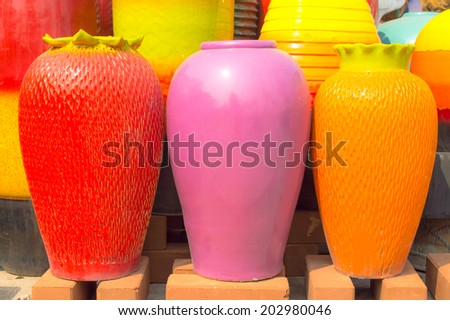 The flowerpot made from baked clay in sunday market - stock photo