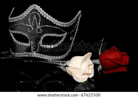 The flowers and Venetian mask  on a black background - stock photo