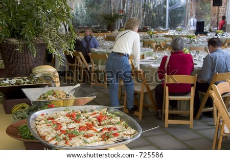 The focus is on the food in the forground. - stock photo