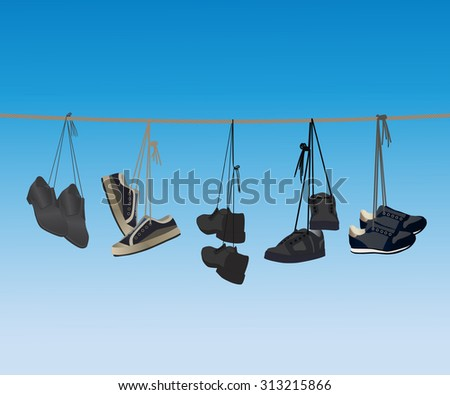 The footwear hanging on a rope. - stock photo