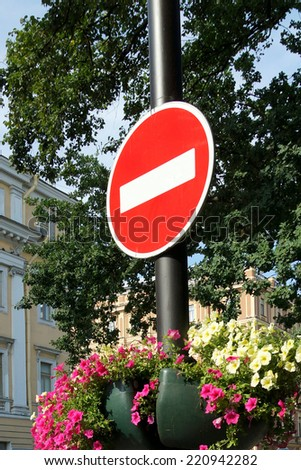 the forbidding road sign on a column - stock photo