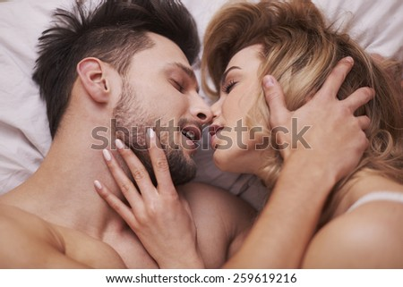 The foreplay of passionate couple - stock photo