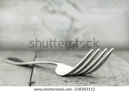The fork, and the table arranged with stained planks  - stock photo
