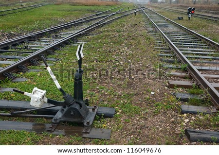 The fork of the railway and traffic lights with shunt - stock photo