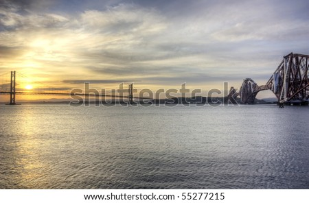 The Forth Road and Rail Bridge at Sunset - stock photo
