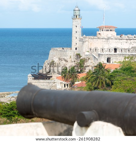 The fortress of El Morro in Havana with an old spanish cannon on the foreground - stock photo