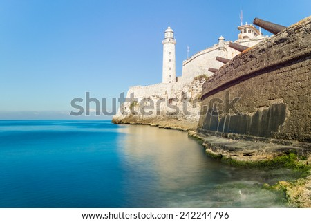 The fortress of El Morro in Havana with an old spanish cannons battery on the foreground - stock photo