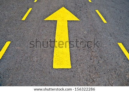 The Forwarded yellow arrow on the road - stock photo