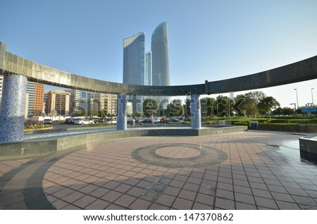 The fountain on the background of skyscrapers in Abu Dhabi, United Arab Emirates - stock photo