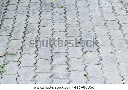 The fragment of a pavement footpath Paving stone with holes - stock photo