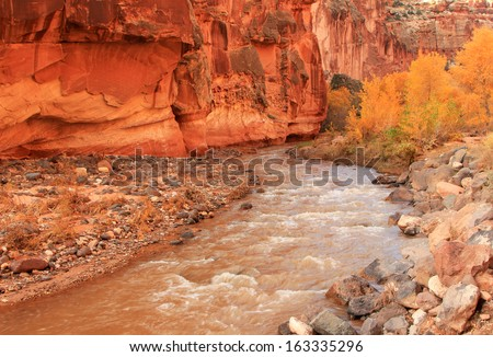 The Fremont River winding through a red rock canyon, Capitol Reef National Park, Utah, USA. - stock photo