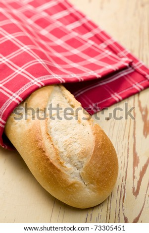 the french baguette on wooden table