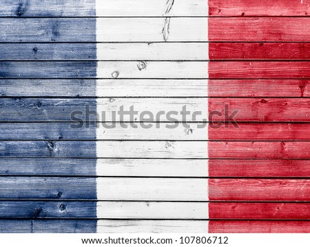 The French flag painted on wooden fence - stock photo