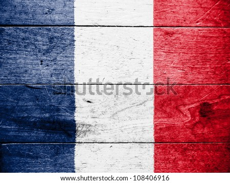 The French flag painted on wooden surface - stock photo